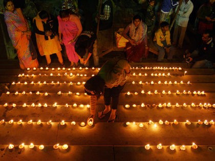 Hindu devotees light oil lamps at Baluwa Ghat during the 'Dev Deepawali' festival in Allahabad on November 28, 2012. 'Dev Deepawali' is observed on the full moon day (Purnima) in the month of Kartik in a traditional Hindu calendar and is the Diwali of the Devas or Gods. AFP PHOTO/ …