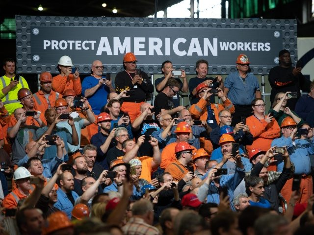 Workers listen as US President Donald Trump speaks about trade at US Steel's Granite City Works steel mill in Granite City, Illinois July 26, 2018. (Photo by SAUL LOEB / AFP) (Photo credit should read SAUL LOEB/AFP via Getty Images)