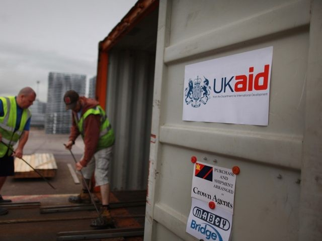 GLOUCESTER, ENGLAND - AUGUST 25: Workers prepare a container as Pre-fabricated bridges are loaded for shipping to Pakistan on August 25, 2010 in Gloucester, England. The Department for International Development are sending 10 bridges to Pakistan to help restore infrastructure damaged in recent floods. 25 shipping containers will carry 500 …