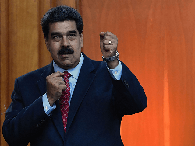 "Venezuelan President Nicolas Maduro leaves after offering a press conference in Caracas, on January 25, 2019. - Venezuela's opposition leader Juan Guaido called Friday for a ""major demonstration"" next week to demand the resignation of President Nicolas Maduro, in his first public appearance since declaring himself ""acting president"" two days …"