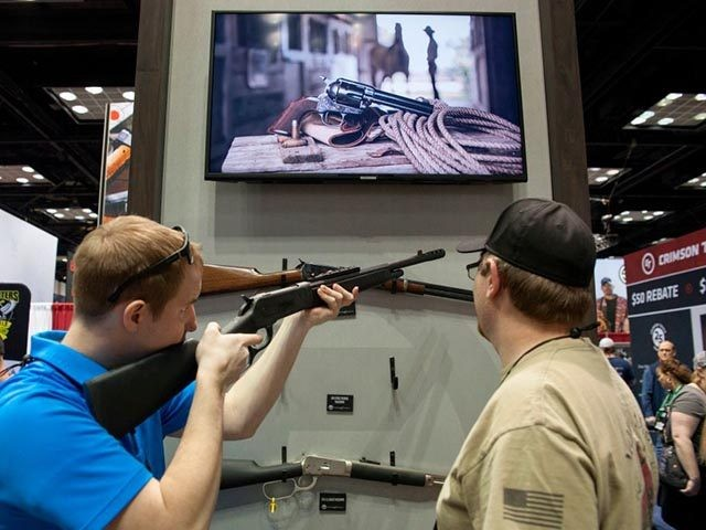 Attendees of the National Rifle Association (NRA) 2019 Annual Meetings examine a deactived rifle on Saturday, April 27, 2019 at the Indiana Convention Center in Indianapolis, Indiana. - Vendors for firearms and shooting accesories from across the country have gathered at the Indiana Convention Center in Indianapolis, Indiana for the …