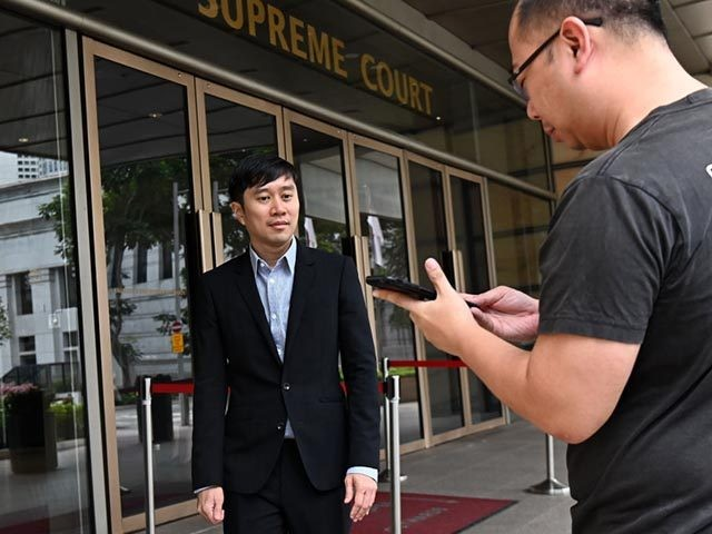 Singaporean activist Jolovan Wham (L) leaves the High Court in Singapore on April 29, 2019 after his sentencing for scandalising the judiciary. (Photo by Roslan RAHMAN / AFP) (Photo credit should read ROSLAN RAHMAN/AFP via Getty Images)