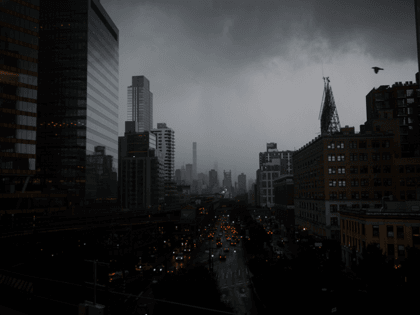 Dark clouds are seen during a thunder storm over Manhattan seen behind the Queensboro Bridge on August August 18, 2019 in New York City. (Photo by Johannes EISELE / AFP) (Photo credit should read JOHANNES EISELE/AFP via Getty Images)