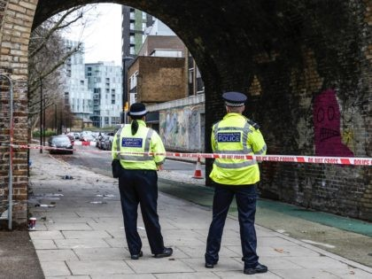 DEPTFORD, ENGLAND - DECEMBER 06: Police Officers guard a crime scene on December 6, 2019 in Deptford, England. Crosslom Davis, 20, known by the stage name Bis, was the second member of the drill group Harlem Spartans to be killed. Another member, Latwaan Griffiths, was stabbed to death in August …