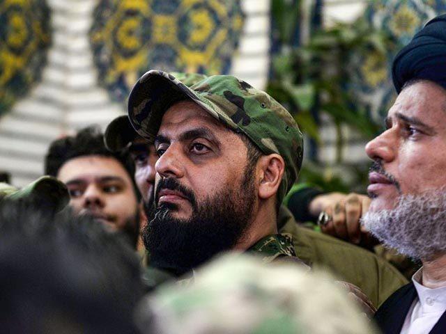 Qais al-Khazali (C) commander of the Asaib Ahl al-Haq pro-Iran faction attends the funeral procession of slain Iraqi paramilitary chief Abu Mahdi al-Muhandis, Iranian military commander Qasem Soleimani and eight others at the Imam Ali Shrine in the shrine city of Najaf in central Iraq on January 4, 2020. - …
