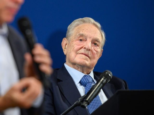 Hungarian-born US investor and philanthropist George Soros (R) listens to Human Rights Watch director Kenneth Roth after delivering a speech on the sidelines of the World Economic Forum (WEF) annual meeting, on January 23, 2020 in Davos. (Photo by FABRICE COFFRINI / AFP) (Photo by FABRICE COFFRINI/AFP via Getty Images)