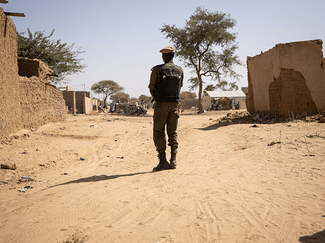A Burkina Faso soldier patrols at a district welcoming Internally Displaced People (IDP) from northern Burkina Faso in Dori, on February 3, 2020. - 600 000 Internally Displaced People (IDP) have fled recent attacks in northern Burkina Faso. (Photo by OLYMPIA DE MAISMONT / AFP) / The erroneous mention[s] appearing …