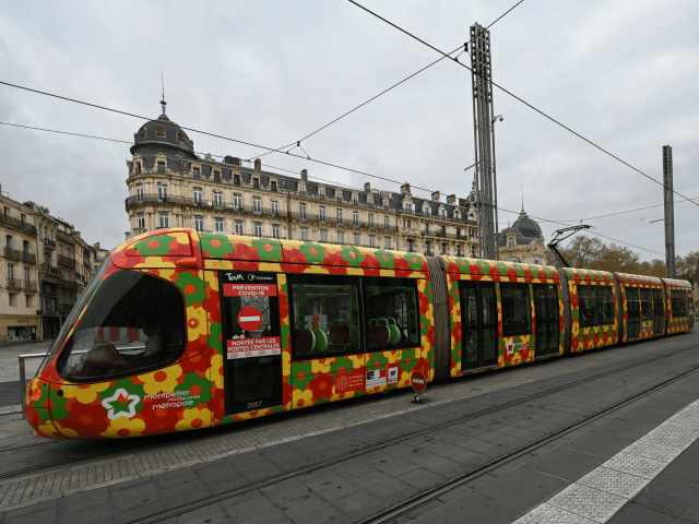 A woman waits for the tram at the Place de la Comedie station in Montpellier, on March 23, 2020, southern France, on the seven day of a strict lockdown in France aimed at curbing the spread of COVID-19 caused by the novel coronavirus. (Photo by Pascal GUYOT / AFP) (Photo …