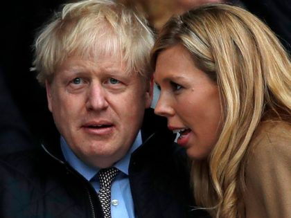 Britain's Prime Minister Boris Johnson (2R) with his partner Carrie Symonds (R) attend the Six Nations international rugby union match between England and Wales at the Twickenham, west London, on March 7, 2020. (Photo by ADRIAN DENNIS / AFP) (Photo by ADRIAN DENNIS/AFP via Getty Images)