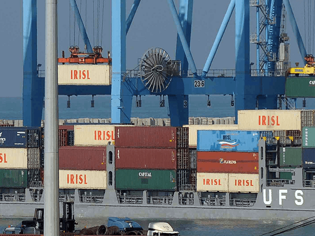 "The logo of the Islamic Republic of Iran Shipping Lines (IRISL) mark containers being lifted from the Francorp in the Israeli port of Ashdod on November 4, 2009. The cargo ship intercepted by the Israeli navy carried what it described as ""hundreds of tonnes"" of weapons, including rockets, grenades and …"