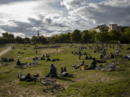 BERLIN, GERMANY - MAY 17: People sit in Görlitzer Park on May 17, 2020 in Berlin, Germany. As authorities continue to ease lockdown restrictions nationwide businesses are reopening, tourism is becoming possible again and more children are returning to school. At the same time health experts are monitoring infection rates …