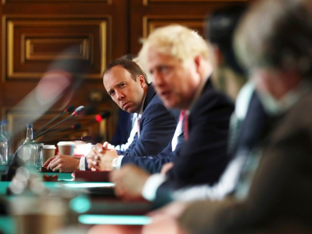 LONDON, ENGLAND - JULY 21: Health Secretary Matt Hancock looks on as Prime Minister Boris Johnson chairs a face-to-face meeting of his cabinet team of ministers, the first since mid-March, at the Foreign and Commonwealth Office (FCO) on July 21, 2020 in London, England. The meeting in the FCO will …