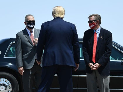 (L-R) Chairwoman of the Arizona Republican Party Kelli Ward, Representative Debbie Lesko, Representative Andy Biggs, Representative Paul Gosar, and Senator Martha McSally (R-AZ) greet US President Donald Trump on the tarmac after he arrived at the international airport in Yuma, Arizona on August 18, 2020. - US President Trump will …