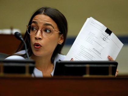 WASHINGTON, DC - AUGUST 24: Rep. Alexandria Ocasio-Cortez (D-NY) asks a question as U.S. Postmaster General Louis DeJoy testifies at a House Oversight and Reform Committee hearing in the Rayburn House Office Building on August 24, 2020 on Capitol Hill in Washington, DC. The committee is holding a hearing on …