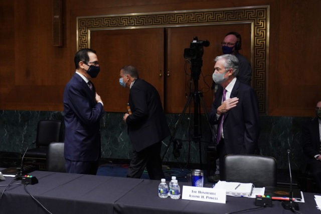 (L-R) US Secretary of the Treasury Steven Mnuchin greets Chairman of the Federal Reserve Jerome Powell before testifying during the Senate's Committee on Banking, Housing, and Urban Affairs hearing examining the quarterly CARES Act report to Congress on September 24, 2020, in Washington, DC. (Photo by Toni L. Sandys / …
