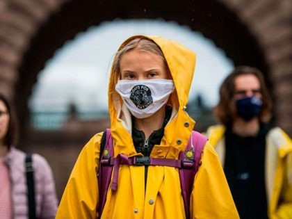 "Swedish climate activist Greta Thunberg protests during a ""Fridays for Future"" protest in front of the Swedish Parliament Riksdagen in Stockholm on October 9, 2020. (Photo by Jonathan NACKSTRAND / AFP) (Photo by JONATHAN NACKSTRAND/AFP via Getty Images)"