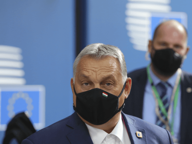 Hungary's Prime Minister Viktor Orban wearing face mask arrives ahead of a two days European Union (EU) summit at the European Council Building in Brussels, on October 15, 2020. - European leaders meet to re-examine the post-Brexit talks under pressure from English Prime Minister to give ground or see Britain …