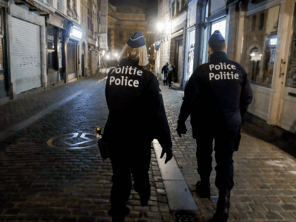 Police officers wearing protective face masks patrol at the start of the curfew in Brussels on October 19, 2020 as a measure against the spread of the COVID-19 pandemic caused by the novel coronavirus. - The consultative committee introduced stricter measures to reduce the risk of spreading COVID-19 as the …