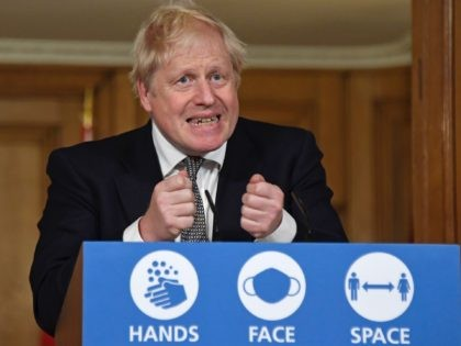 LONDON, UNITED KINGDOM - OCTOBER 31: Britain's Prime Minister Boris Johnson gestures as he speaks during a press conference in 10 Downing Street on October 31, 2020 in London, England. The PM announced a new four week lockdown across England, starting Thursday, to help combat a coronavirus surge. (Photo by …