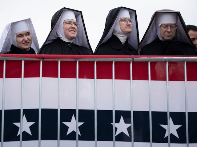 """Nuns wait for US President Donald Trump to speak during a """"Make America Great Again"""" rally at Total Sports Park on November 1, 2020, in Washington, Michigan. (Photo by Brendan Smialowski / AFP) (Photo by BRENDAN SMIALOWSKI/AFP via Getty Images)"""