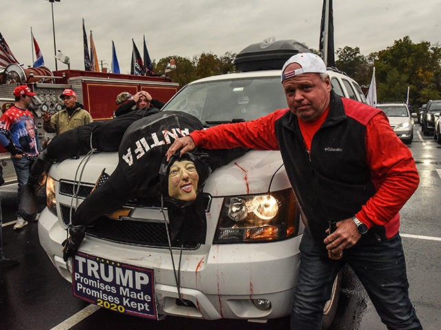 WEST NYACK, NY - NOVEMBER 01: A Trump supporter with an effigy of a dead Antifa person on his car attends a pro-Trump rally on November 1, 2020 in West Nyack, New York. With just two day left before the U.S. Presidential election, Trump supporters coordinated large caravans across the …