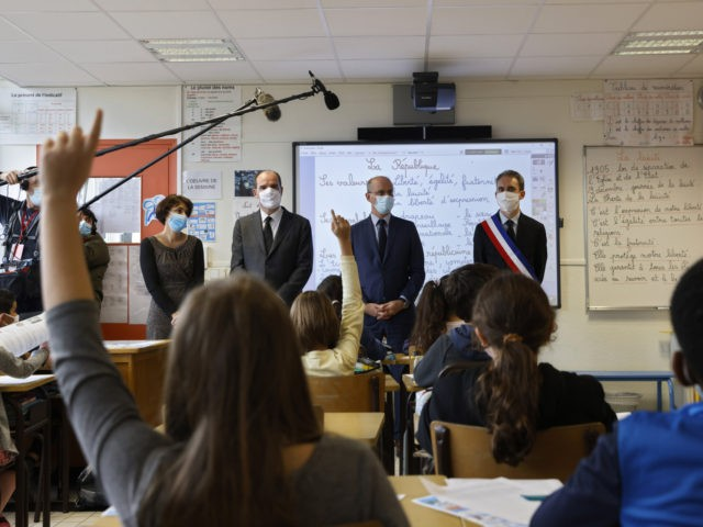 French Prime Minister Jean Castex (2ndL) and French Education, Youth and Sports Minister Jean-Michel Blanquer (2ndR) attend a homage to slained French history teacher Samuel Paty, on November 2, 2020 at a school in Conflans Sainte-Honorine, as France honours the teacher beheaded in front of his school by a suspected …