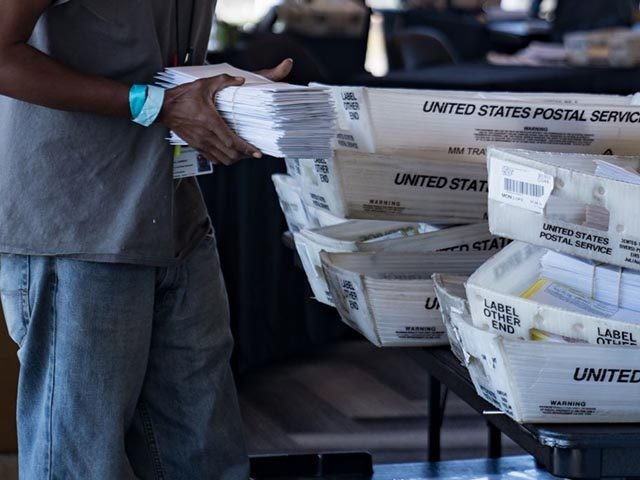 ATLANTA, GA - NOVEMBER 02: An election worker processes absentee ballots at State Farm Arena on November 2, 2020 in Atlanta, Georgia. With record-breaking early voting turnout, Americans will head to the polls tomorrow for the last chance to cast their vote for incumbent U.S. President Donald Trump or Democratic …