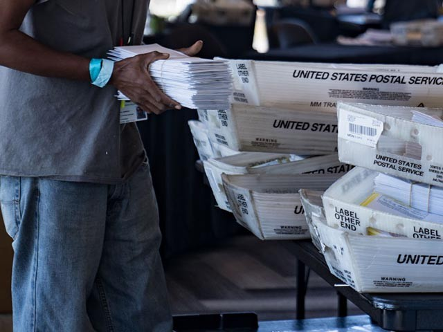ATLANTA, GA - NOVEMBER 02: An election worker processes absentee ballots at State Farm Arena on November 2, 2020 in Atlanta, Georgia. With record-breaking early voting turnout, Americans will head to the polls tomorrow for the last chance to cast their vote for incumbent U.S. President Donald Trump or Democratic nominee Joe Biden in the 2020 presidential election. (Photo by Megan Varner/Getty Images)