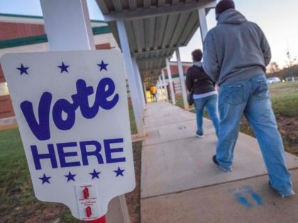Voters arrive at Waddell Language Academy in Charlotte, North Carolina shortly after the polls opened on November 3, 2020. - The United States started voting Tuesday in an election amounting to a referendum on Donald Trump's uniquely brash and bruising presidency, which Democratic opponent and frontrunner Joe Biden urged Americans …