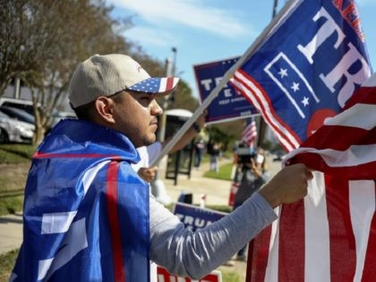 HOUSTON, TX - NOVEMBER 03: A President Donald Trump supporter during a rally on West Gray Street on November 3, 2020 in Houston, Texas. After a record-breaking early voting turnout, Americans head to the polls on the last day to cast their vote for incumbent U.S. President Donald Trump or …