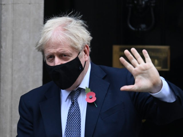 Britain's Prime Minister Boris Johnson, wearing a face mask, leaves number 10 Downing Street in central London to take part in Prime Minister's Questions (PMQs) in Parliament on November 4, 2020. (Photo by DANIEL LEAL-OLIVAS / AFP) (Photo by DANIEL LEAL-OLIVAS/AFP via Getty Images)