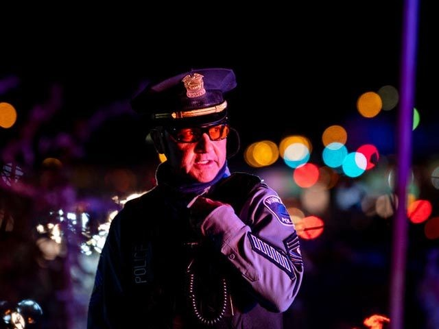 MINNEAPOLIS, MN - NOVEMBER 04: A member of the Minneapolis Police Department speaks into his radio as demonstrators march on to highway I-94 on November 4, 2020 in Minneapolis, Minnesota. The demonstration, scheduled as a critique of President Donald Trump's attempts to halt ballots from being counted in yesterday's election, …