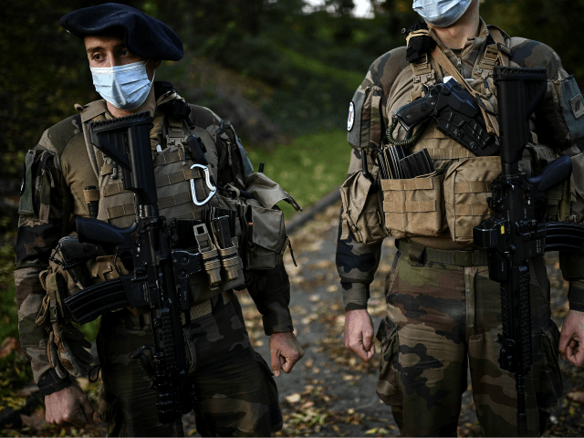 """French soldiers of the Sentinelle force get ready before setting off on a patrol at their barrack at an undisclosed location in northern suburban Paris on November 6, 2020. - The Sentinelle force aims at protecting sensitive """"points"""" of the French territory from terrorism. (Photo by Christophe ARCHAMBAULT / AFP) …"""