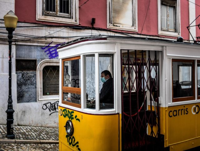 A tram driver waits for passengers at Gloria Tram in downtown Lisbon on November 7, 2020. - The Portuguese government is holding an extraordinary ministers' council to decide on concrete measures to fight the spread of the coronavirus, which could include a night curfew as it already exists in several …