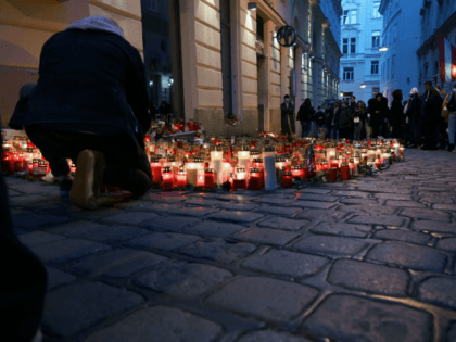 Inhabitants light candles as they pay tribute to the victims of the attack at one of the crime scenes at Seitenstettengasse in the city centre of Vienna on November 7, 2020. - The Austrian government ordered the closure on November 6 of two mosques in the capital Vienna frequented by …