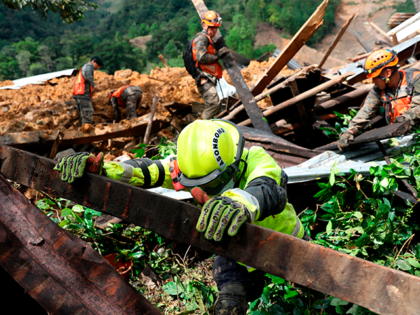 Rescue workers search for victims of a musdlide caused by the passage of Hurricane Eta in the village of Queja, in San Cristobal Verapaz, Guatemala on November 7, 2020. - About 150 people have died or remain unaccounted for in Guatemala due to mudslides caused by powerful storm Eta, which …