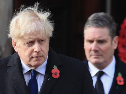 Britain's Prime Minister Boris Johnson (L) and Britain's main opposition Labour Party leader Keir Starmer attend the Remembrance Sunday ceremony at the Cenotaph on Whitehall in central London, on November 8, 2020. - Remembrance Sunday is an annual commemoration held on the closest Sunday to Armistice Day, November 11, the …