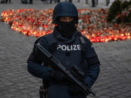 An armed police officer stands guard before the arrival of Austrian Chancellor Kurz and President of the European Council to pay respects to the victims of the recent terrorist attack in Vienna, Austria on November 9,2020. (Photo by JOE KLAMAR / AFP) (Photo by JOE KLAMAR/AFP via Getty Images)