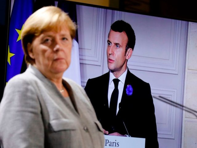 German Chancellor Angela Merkel attends a virtual news conference os security issues with French President Emmanuel Macron (on the screen), Austrian Chancellor Sebastian Kurz, Netherlands Prime Minister Mark Rutte, European Commission President Ursula von der Leyen and European Council President Charles Michel, at the Chancellery in Berlin on November 10, …