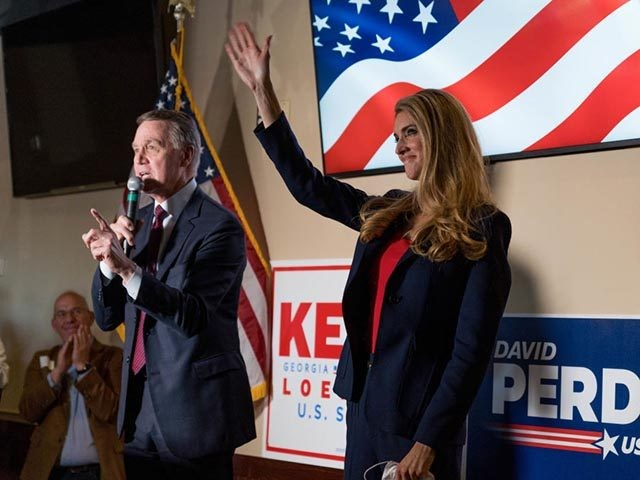 CUMMING, GA - NOVEMBER 13: U.S. Sen David Perdue (R-GA) and Sen Kelly Loeffler (R-GA) speaks at a campaign event to supporters at a restaurant on November 13, 2020 in Cumming, Georgia. There is a runoff election between Loeffler and Democratic opponent Raphael Warnock scheduled for Jan. 5, along with …