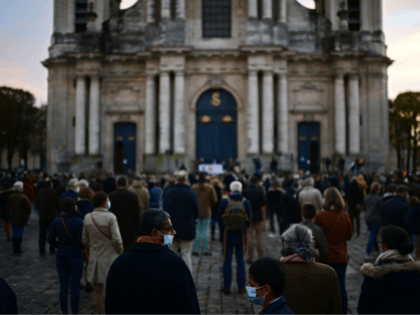 Catholic faitfuls take part in a rally to protest against COVID-19 restrictions under which masses are banned in churches, on November 15, 2020 in Versailles, outside Paris, as France is on a second lockdown to tackle the spread of the Covid-19 pandemic caused by the novel coronavirus. (Photo by MARTIN …