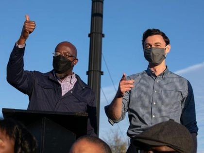 MARIETTA, GA - NOVEMBER 15: Democratic U.S. Senate candidates Jon Ossoff (R) and Raphael Warnock (L) of Georgia hold a rally on November 15, 2020 in Marietta, Georgia. Ossoff and Warnock face incumbent U.S. Sens. David Purdue (R-GA) and Kelly Loeffler (R-GA) respectively in a January 5 runoff election. (Photo …