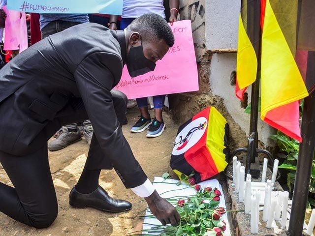 Ugandan musician turned politician Robert Kyagulanyi, also known as Bobi Wine, lays flowers during a prayer for the victims of the protest against his arrest at the headquarters of his opposition party, the National Unity Platform (NUP), in Kampala, Uganda, on November 21, 2020. - A Ugandan court on November …