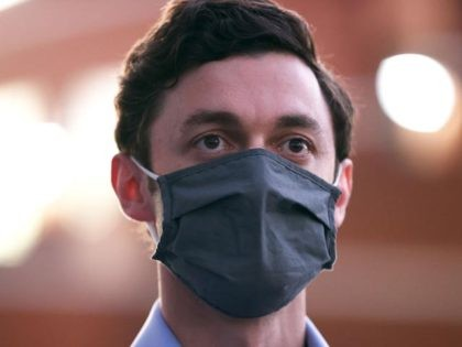 "COLUMBUS, GEORGIA - OCTOBER 29: Democratic U.S. Senate candidate Jon Ossoff wears a protective mask as he looks on during a ""Get Out the Early Vote"" drive-in campaign event on October 29, 2020 in Columbus, Georgia. With less than a week to go until Election Day, Democratic candidates for the …"