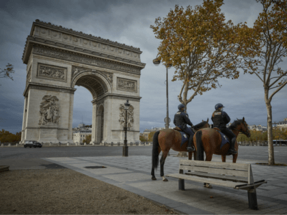 PARIS, FRANCE - OCTOBER 31: Mounted Police patrol around the Arc de Triomphe on the second day of national lockdown confinement as part of new increased security in the wake of recent terrorist attacks on October 31, 2020 in Paris, France. France has imposed another national lockdown for a minimum …