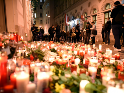 VIENNA, AUSTRIA - NOVEMBER 05: People gather at a makeshift memorial at the scene of a terror attack last Monday in which a gunman shot a number of people, on November 05, 2020 in Vienna, Austria. Kujtim Fejzulai, a 20-year-old with Austrian and North Macedonian citizenship who had been radicalized …