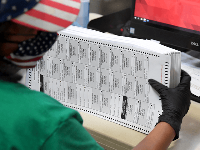 A Clark County election worker scans mail-in ballots at the Clark County Election Department on November 7, 2020 in North Las Vegas, Nevada. Joe Biden won Pennsylvania and Nevada and was declared the winner in the presidential race against Donald Trump. (Photo by Ethan Miller/Getty Images)