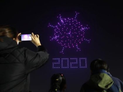 SEOUL, SOUTH KOREA - NOVEMBER 13: Drones fly over the Olympic Park make the shape of coronavirus to send messages to support the country and share measures to contain the spread of the coronavirus (COVID-19) on November 13, 2020 in Seoul, South Korea. South Korea's new coronavirus cases spiked to …