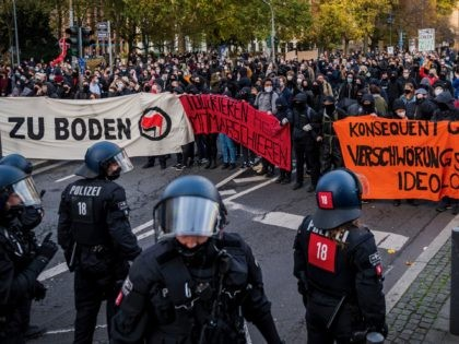 FRANKFURT AM MAIN, GERMANY - NOVEMBER 14: Left-wing antifa counter-demonstrators block a street to protest against Querdenken movement on November 14, 2020 in Frankfurt, Germany. Some hundreds of demonstrators gather to protest against coronavirus lockdown restrictions Police, who have in the past looked on without strongly intervening at Querdenken gatherings …