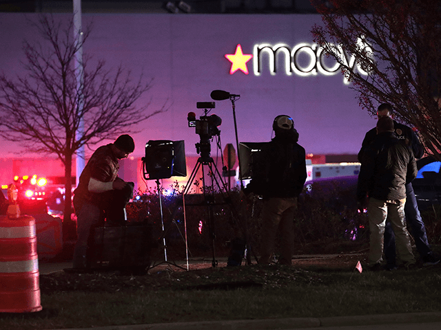 A television news crew reports from outside the Mayfair Mall after a gunman opened fire on November 20, 2020 in Wauwatosa, Wisconsin. Several people were reported to have been injured with the gunman still at large. (Photo by Scott Olson/Getty Images)